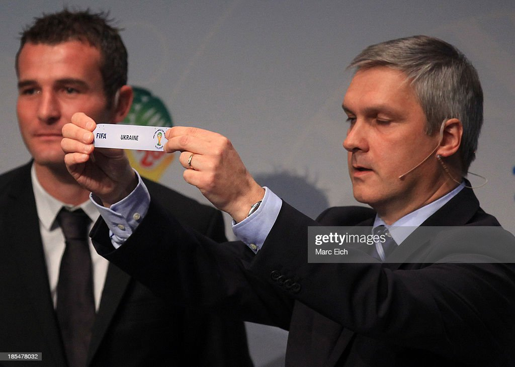 Gordon Savic, head of FIFA World Cup Qualifiers, shows the name of Ukraine during the FIFA World Cup 2014 European Zone Play-Off Match Draw at the FIFA headquarter on October 21, 2013 in Zurich, Switzerland.
