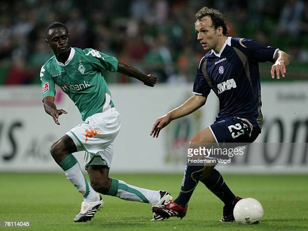 Gordon Schildenfeld of Zagreb and Boubacar Sanogo of Bremen in action during the Champions League third qualifying round match between Werder Bremen...