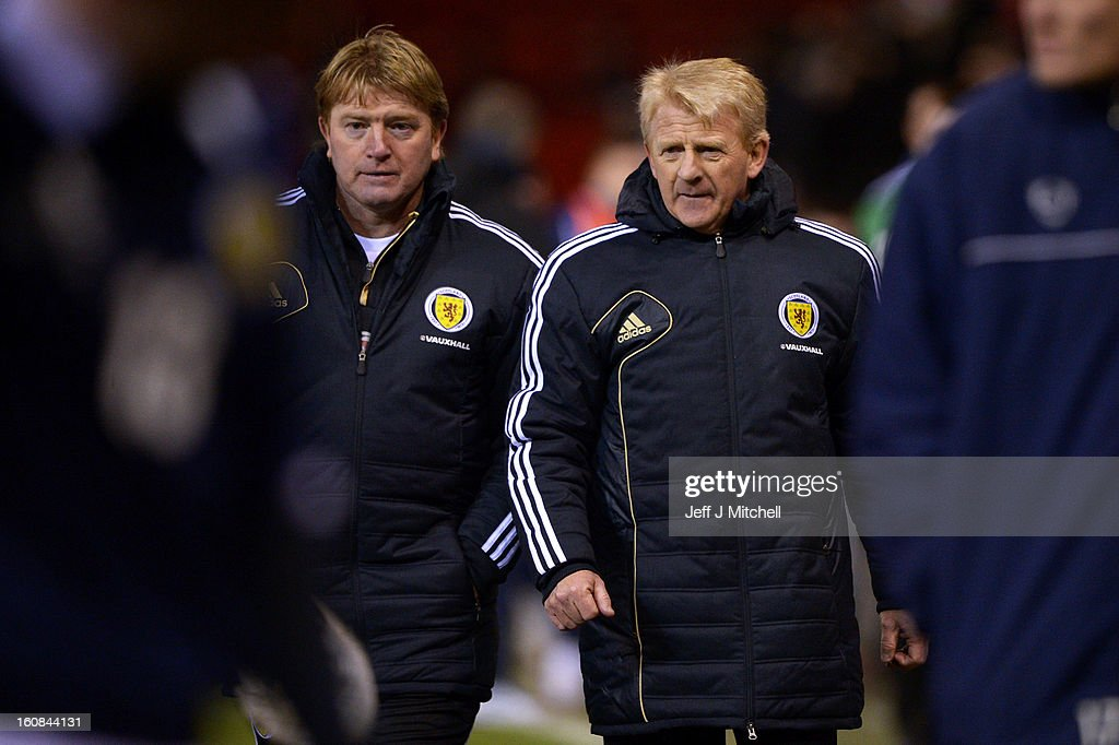 Gordon Stachan coach of Scotland and Stuart McCall walk of the pitch at the end of the international friendly match between Scotland and Estonia at Pittodrie Stadium on February 6, 2013 in Aberdeen, Scotland.