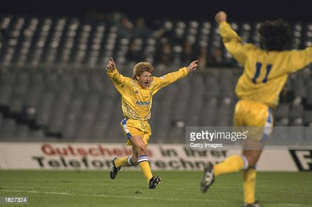 Gordon Strachan and Gary Speed both of Leeds celebrate a goal during the European Cup first round replay match against Stuttgart in Barcelona Spain...