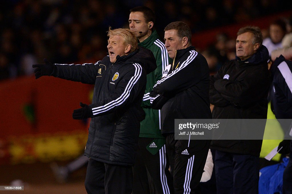<a gi-track='captionPersonalityLinkClicked' href=/galleries/search?phrase=Gordon+Strachan&family=editorial&specificpeople=243133 ng-click='$event.stopPropagation()'>Gordon Strachan</a>, manager of Scotland and his assistant <a gi-track='captionPersonalityLinkClicked' href=/galleries/search?phrase=Mark+McGhee&family=editorial&specificpeople=684163 ng-click='$event.stopPropagation()'>Mark McGhee</a> react during the international friendly match between Scotland and Estonia at Pittodrie Stadium on February 6, 2013 in Aberdeen, Scotland.