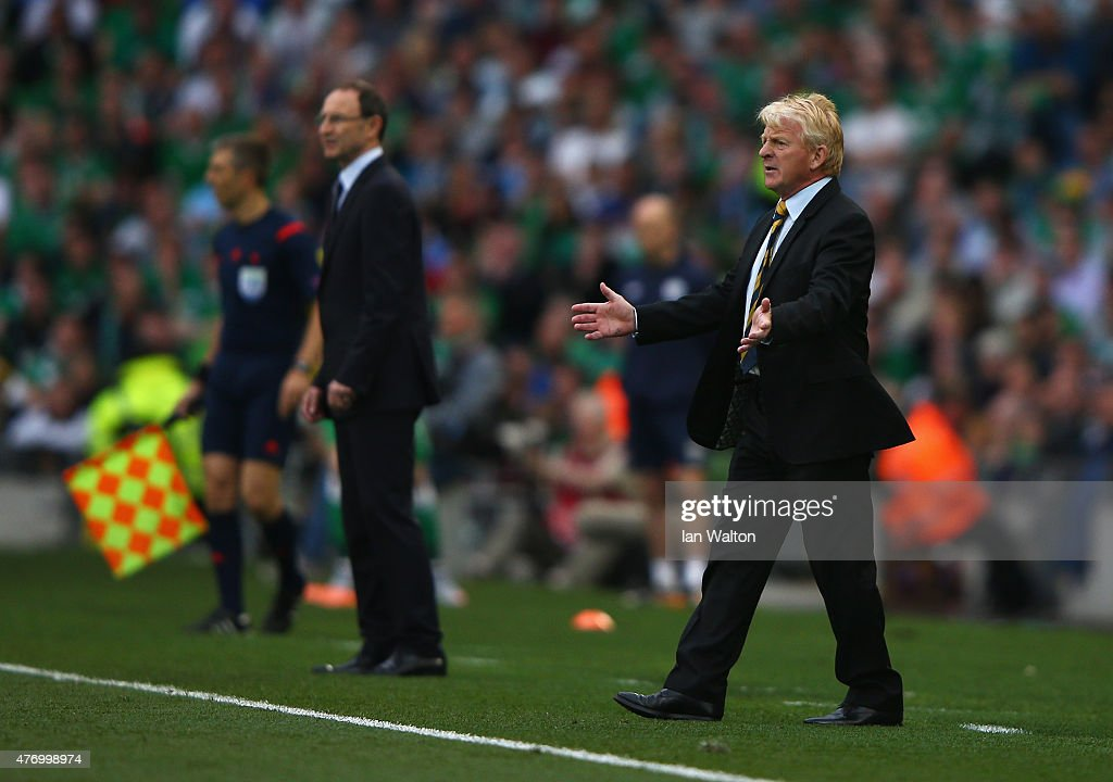 <a gi-track='captionPersonalityLinkClicked' href=/galleries/search?phrase=Gordon+Strachan&family=editorial&specificpeople=243133 ng-click='$event.stopPropagation()'>Gordon Strachan</a>, manager of Scotland reacts with <a gi-track='captionPersonalityLinkClicked' href=/galleries/search?phrase=Martin+O%27Neill&family=editorial&specificpeople=201190 ng-click='$event.stopPropagation()'>Martin O'Neill</a>, manager of Republic of Ireland during the UEFA EURO 2016 Qualifier Group D match between Republic of Ireland and Scotland at Aviva Stadium on June 13, 2015 in Dublin, Ireland.