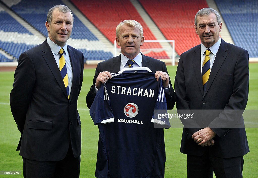Gordon Strachan (C), newly appointed manager for Scotland's football team, poses with a jersey bearing his name as he stands alongside Stewart Regan (L), Chief Executive of the Scottish Football Association and Campbell Ogilvie, President of the Scottish Football Association following a press conference in Glasgow on January 15, 2013. Strachan, a former Scotland midfielder, had long been the favourite to replace Craig Levein, who was sacked in November after a poor start to a World Cup qualifying campaign left Scotland's hopes of playing at Brazil 2014 in tatters.