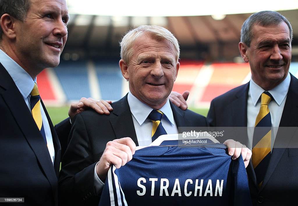 <a gi-track='captionPersonalityLinkClicked' href=/galleries/search?phrase=Gordon+Strachan&family=editorial&specificpeople=243133 ng-click='$event.stopPropagation()'>Gordon Strachan</a> (C) poses holding a Scotland shirt with Scottish FA Chief Executive Stewart Regan and Scottish FA President Campbell Ogilvie (R) after being officially presented as the new national team coach of Scotland during a press conference at Hampden Park Stadium on January 15, 2013 in Glasgow, Scotland.