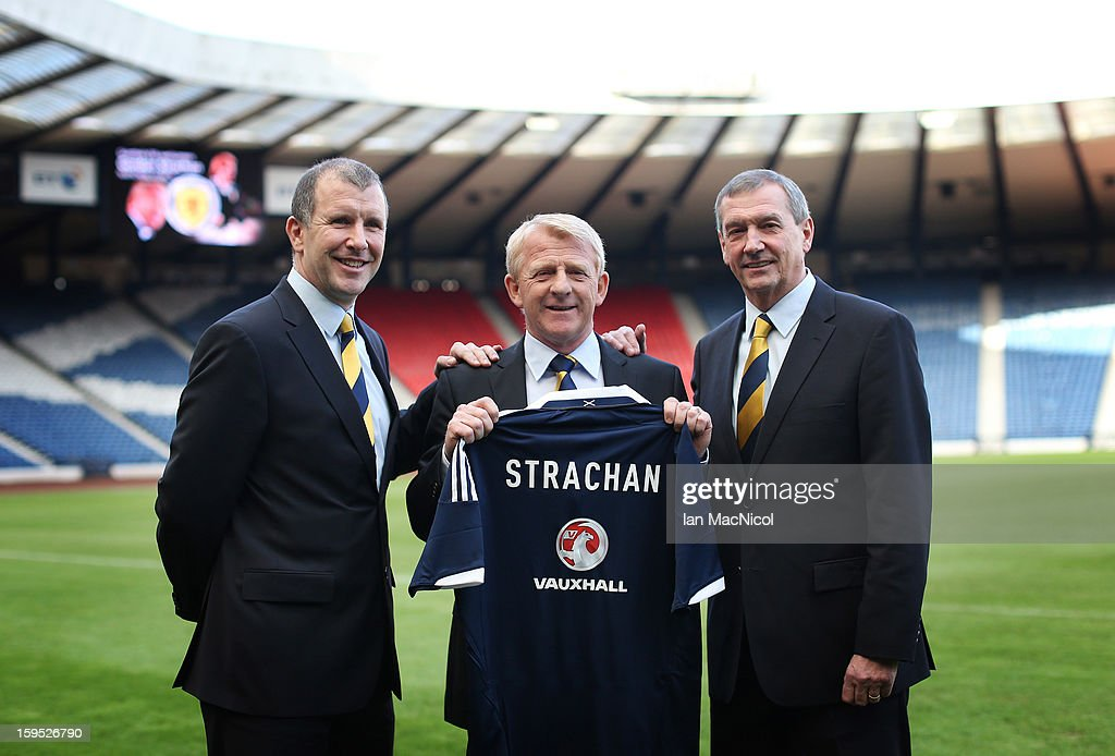 Gordon Strachan (C) poses holding a Scotland shirt with Scottish FA Chief Executive Stewart Regan and Scottish FA President Campbell Ogilvie (R) after being officially presented as the new national team coach of Scotland during a press conference at Hampden Park Stadium on January 15, 2013 in Glasgow, Scotland.