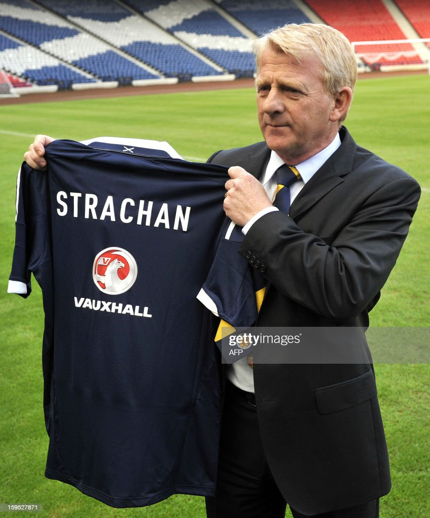 Gordon Strachan poses with a jersey bearing his name following the announcement of his appointment as manager for Scotland's football team in Glasgow on January 15, 2013. Strachan, a former Scotland midfielder, had long been the favourite to replace Craig Levein, who was sacked in November after a poor start to a World Cup qualifying campaign left Scotland's hopes of playing at Brazil 2014 in tatters.