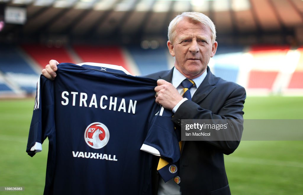 Gordon Strachan poses with a Scotland shirt after being officially presented as the new national team coach of Scotland during a press conference at Hampden Park Stadium on January 15, 2013 in Glasgow, Scotland.