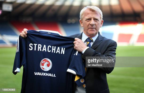 Gordon Strachan poses with a Scotland shirt after being officially presented as the new national team coach of Scotland during a press conference at...