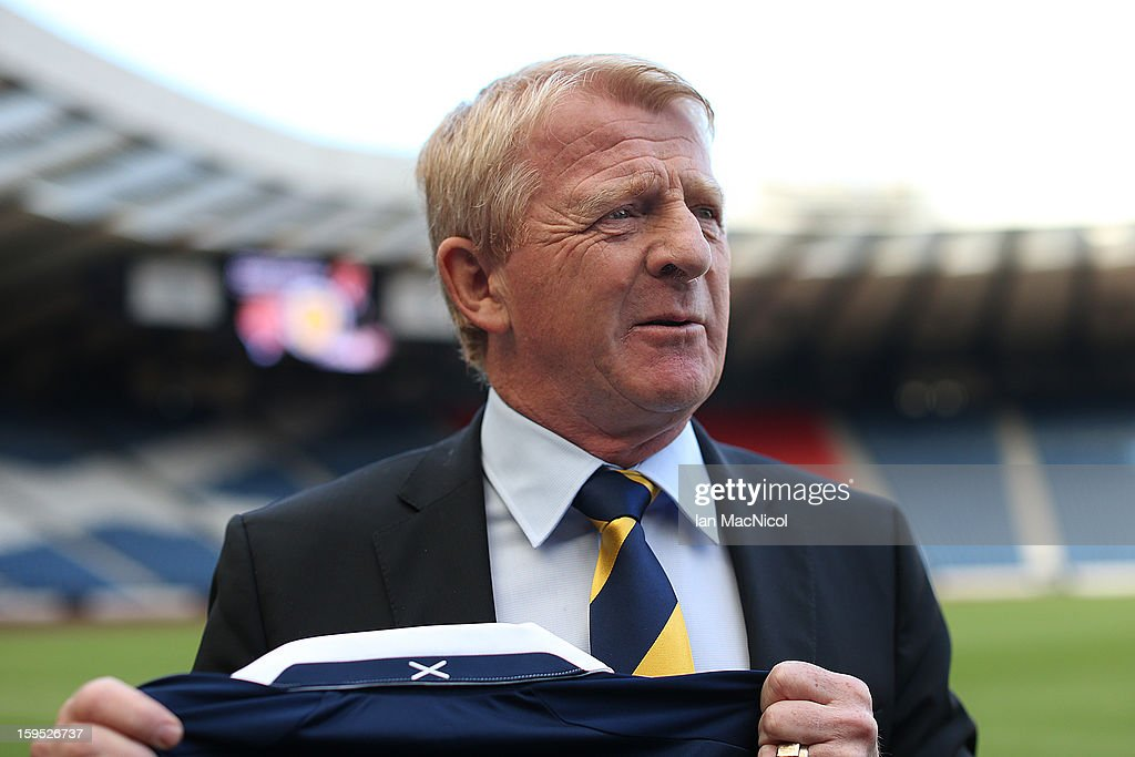 <a gi-track='captionPersonalityLinkClicked' href=/galleries/search?phrase=Gordon+Strachan&family=editorial&specificpeople=243133 ng-click='$event.stopPropagation()'>Gordon Strachan</a> poses with a Scotland shirt after being officially presented as the new national team coach of Scotland during a press conference at Hampden Park Stadium on January 15, 2013 in Glasgow, Scotland.