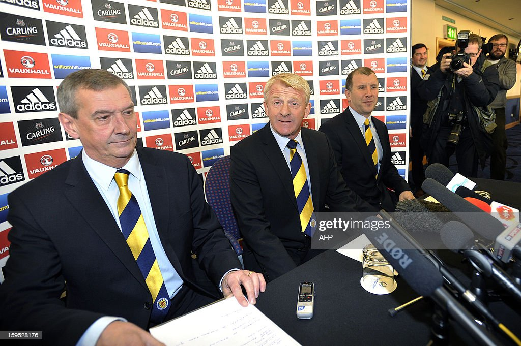 Gordon Strachan (C) sits between Stewart Regan (R), Chief Executive of the Scottish Football Association and Campbell Ogilvie, President of the Scottish Football Association, during a press conference announcing his appointment as manager for Scotland's football team in Glasgow on January 15, 2013. Strachan, a former Scotland midfielder, had long been the favourite to replace Craig Levein, who was sacked in November after a poor start to a World Cup qualifying campaign left Scotland's hopes of playing at Brazil 2014 in tatters.