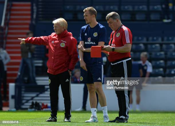 Gordon Strachan the manager of Scotland Darren Fltecher and Mark McGhee the assistant manager of Scotland look on during the Scotland training...