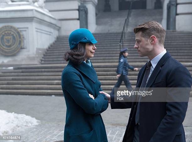 Gordon tries to protect Dr Leslie Tompkins in the 'Under the Knife' episode of GOTHAM airing Monday April 20 2015 on FOX