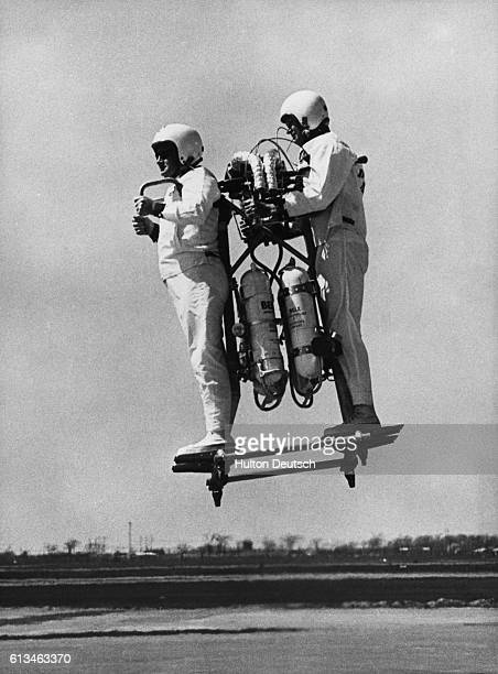 Gordon Yaeger flies the Bell Pogo a twoman flying rocket transport developed by the Bell Aerosystems Company William P Burns is the passenger in...