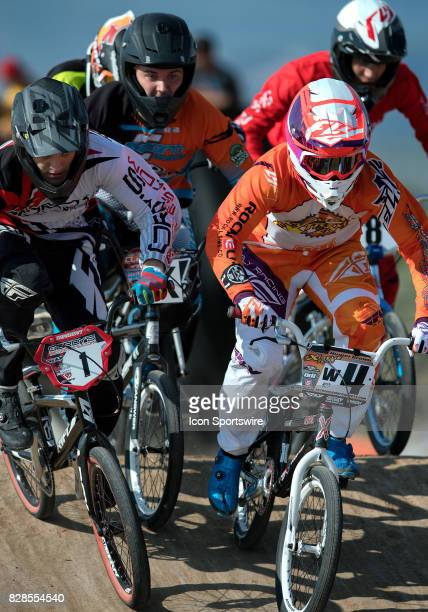 Gordy's Bicycles' Tre Heximer and Extreme Team's Hunter Brown fight through traffic during 16 Expert action at the USA BMX Mile High Nationals on...