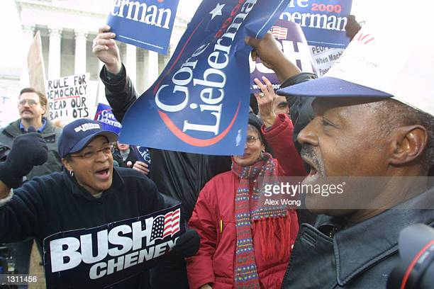 Gore and Bush supporters face off during a protest December 11 2000 outside the US Supreme Court in Washington The US Supreme Court began hearing...