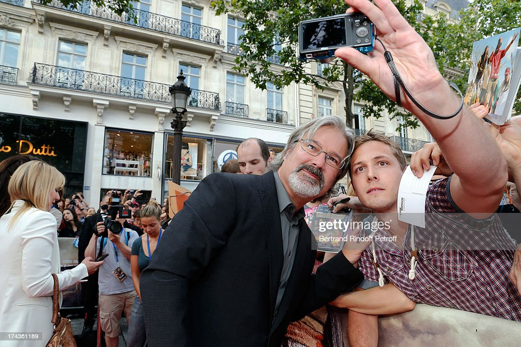<a gi-track='captionPersonalityLinkClicked' href=/galleries/search?phrase=Gore+Verbinski&family=editorial&specificpeople=538751 ng-click='$event.stopPropagation()'>Gore Verbinski</a> poses with a fan during the Paris Premiere of 'Lone Ranger' on July 24, 2013 at UGC Normandy in Paris, France.