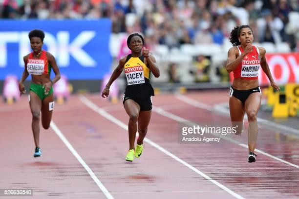 Gorete Semedo of Sao Tome and Príncipe Simone Facey of Jamaica and Mujinga Kambundji of Switzerland compete in the women's 100 meters heats during...