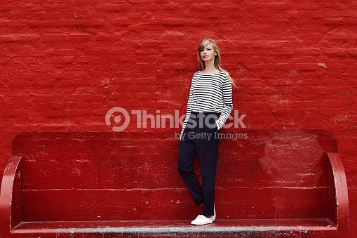 Gorgeous against red : Stock Photo