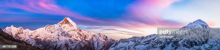 Gorgeous alpenglow sunset snowy peaks panorama Annapurna Sanctuary Himalayas Nepal