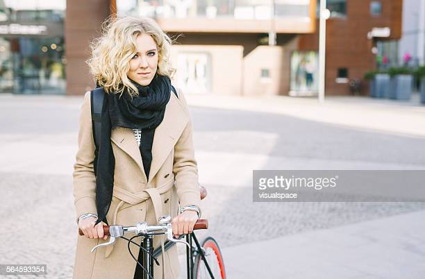 Gorgeous Blond Girl Hanging Out In The City With Bicycle