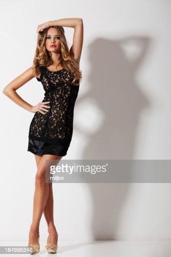 Gorgeous blonde posing in mini dress
