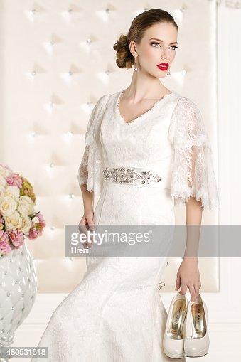 Gorgeous bride in a white room : Bildbanksbilder