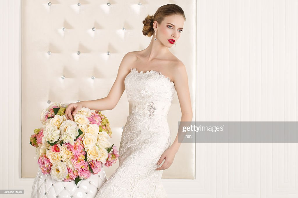 Gorgeous bride in a white room : Stock Photo