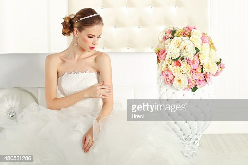 Gorgeous bride on sofa : Stock Photo