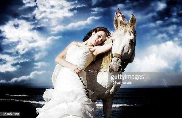 Gorgeous bride with white horse