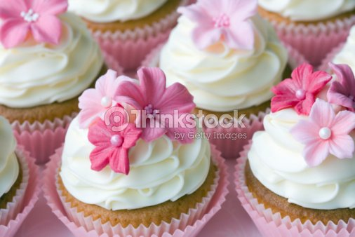 Gorgeous cupcakes with white icing and small pink flowers stock gorgeous cupcakes with white icing and small pink flowers stock photo mightylinksfo