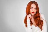 Photoshot of gorgeous redhead girl with bright makeup