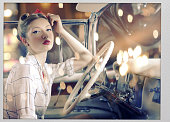 .Gorgeous retro diva wearing pin up clothes in  convertible car
