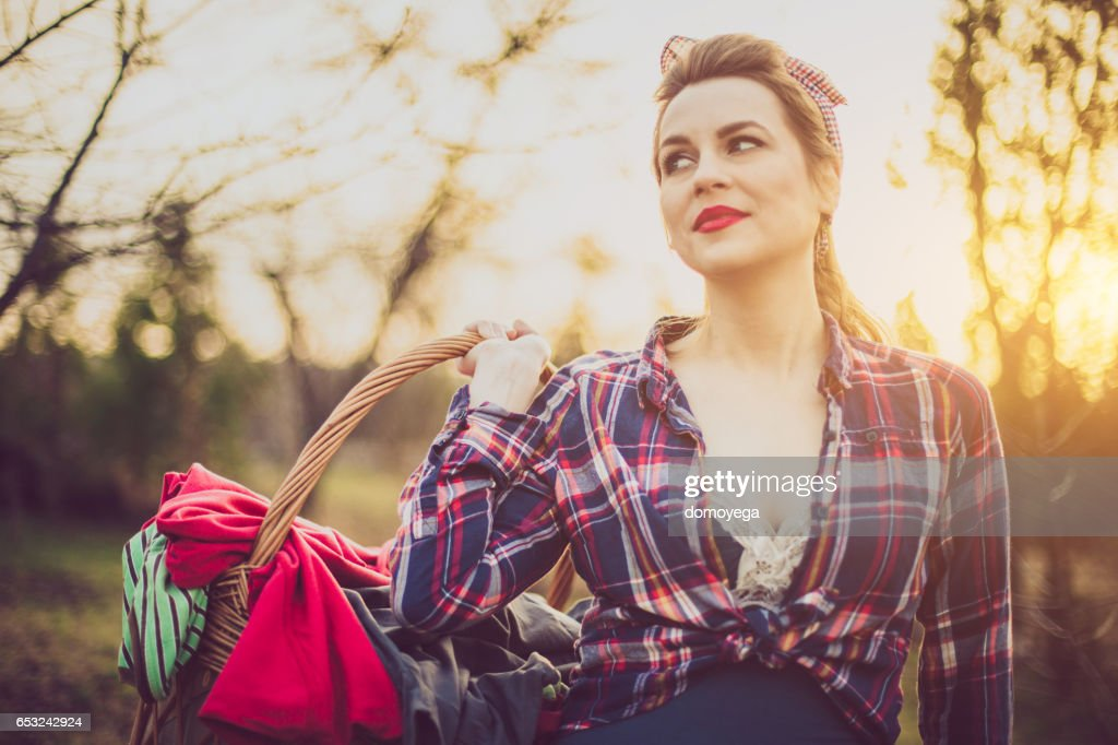Gorgeous vintage style girl carrying a laundry basket : Stock Photo
