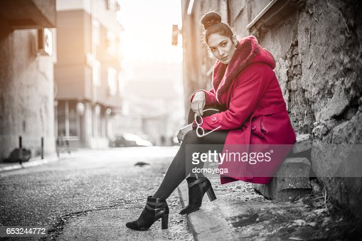 Gorgeous woman in a red coat : Stock-Foto