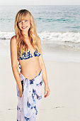 Gorgeous woman in sarong and bikini top at beach