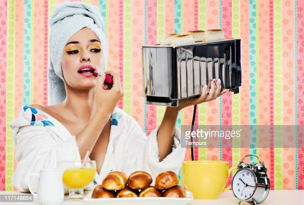 Gorgeous woman's, breakfast lipstick and toaster.