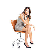 Gorgeous young businesswoman sitting on a chair