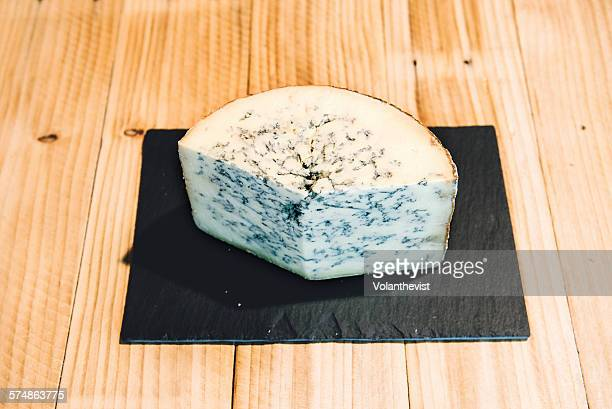 Gorgonzola cheese on a wooden cheese counter