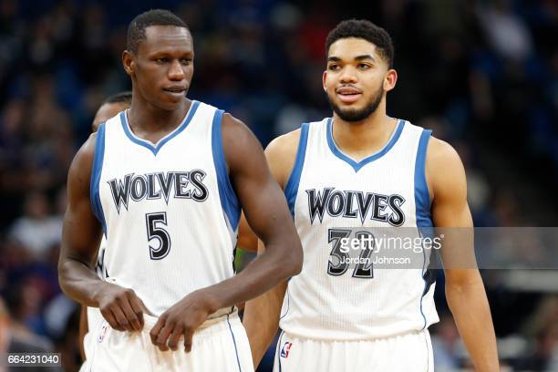 Gorgui Dieng and KarlAnthony Towns of the Minnesota Timberwolves talk during the game against the Portland Trail Blazers at the Target Center in...