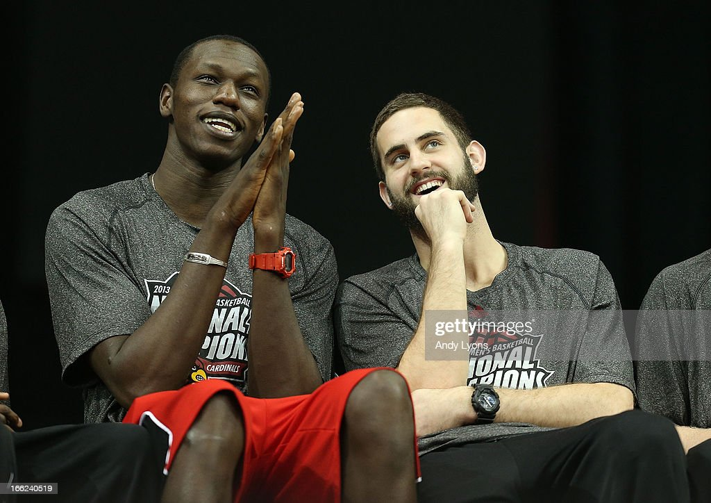 Gorgui Dieng and Luke Hancock of the Louisville Cardinals watch a video presentation during the Louisville Cardinals NCAA Basketball Celebration to mark the NCAA championship by the Mens team and the runner-up finish by the womens team at KFC YUM! Center on April 10, 2013 in Louisville, Kentucky.