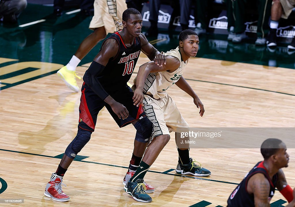 Gorgui Dieng #10 of the Louisville Cardinals defends Zach LeDay #3 of the South Florida Bulls during the game at the Sun Dome on February 17, 2013 in Tampa, Florida.