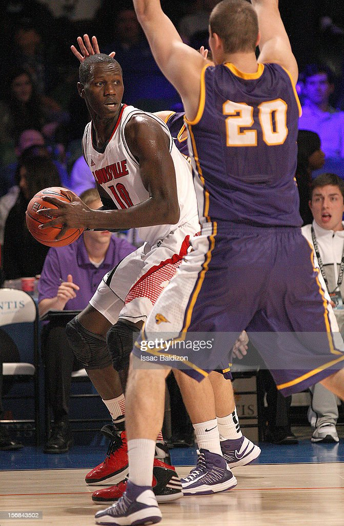 Gorgui Dieng #10 of the Louisville Cardinals dribbles against Jake Koch #20 of the Northern Iowa Panthers during the Battle 4 Atlantis tournament at Atlantis Resort on November 22, 2012 in Nassau, Paradise Island, Bahamas.