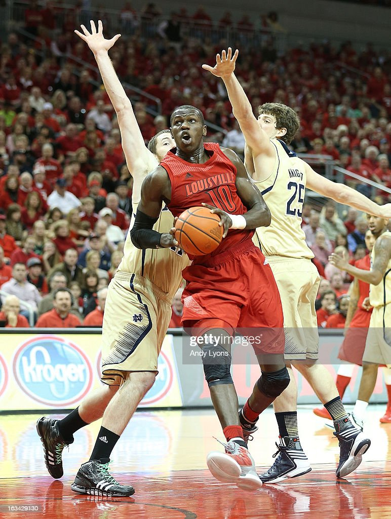Gorgui Dieng #11 of the Louisville Cardinals drives to the basket during the game against the Notre Dame Fighting Irish at KFC YUM! Center on March 9, 2013 in Louisville, Kentucky.