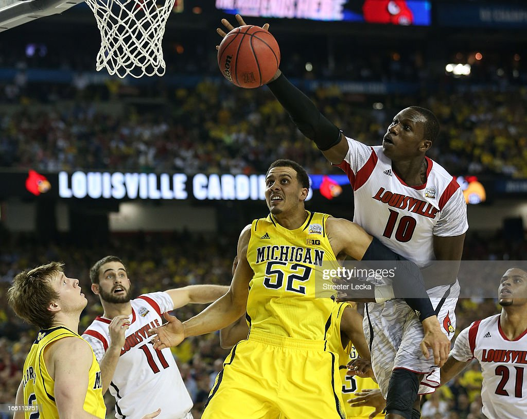 Gorgui Dieng #10 of the Louisville Cardinals goes for the ball over Jordan Morgan #52 of the Michigan Wolverines in the second half during the 2013 NCAA Men's Final Four Championship at the Georgia Dome on April 8, 2013 in Atlanta, Georgia.