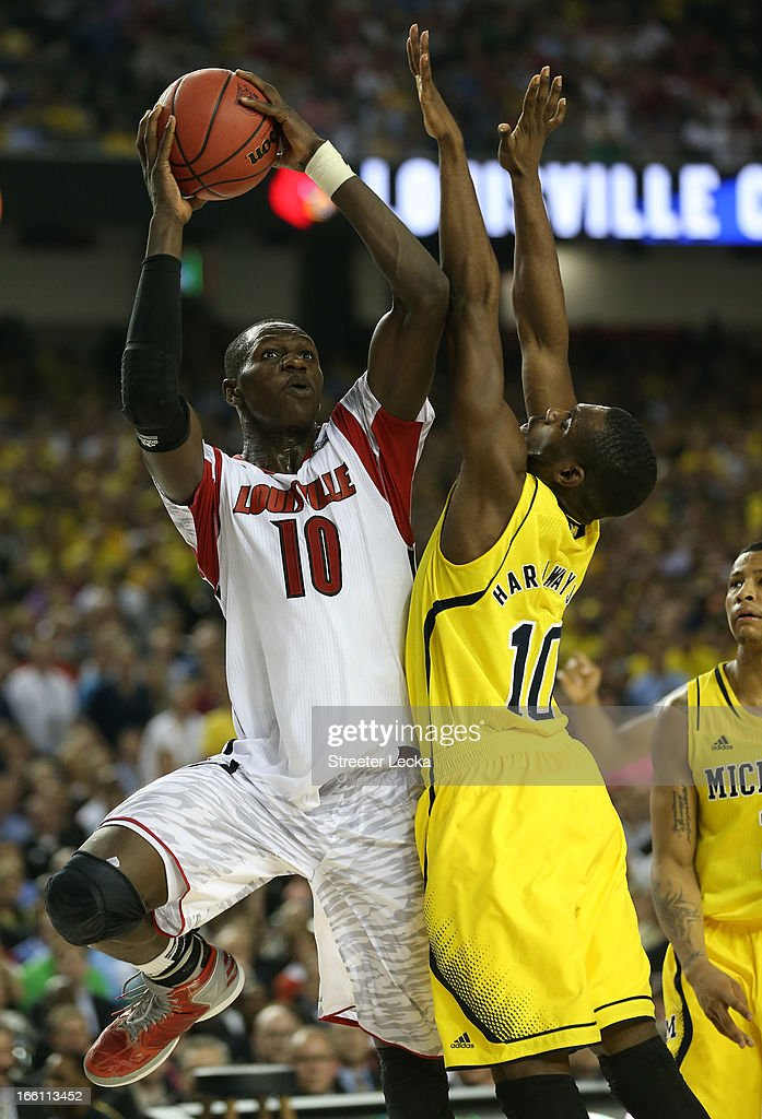 Gorgui Dieng #10 of the Louisville Cardinals goes up for a shot over Tim Hardaway Jr. #10 of the Michigan Wolverines in the second half during the 2013 NCAA Men's Final Four Championship at the Georgia Dome on April 8, 2013 in Atlanta, Georgia.