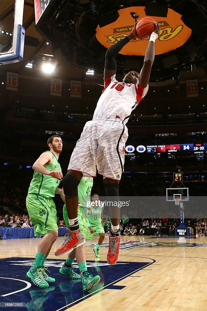 Gorgui Dieng #10 of the Louisville Cardinals grabs a rebound against the Notre Dame Fighting Irish during the semifinals of the Big East Men's Basketball Tournament at Madison Square Garden on March 15, 2013 in New York City.