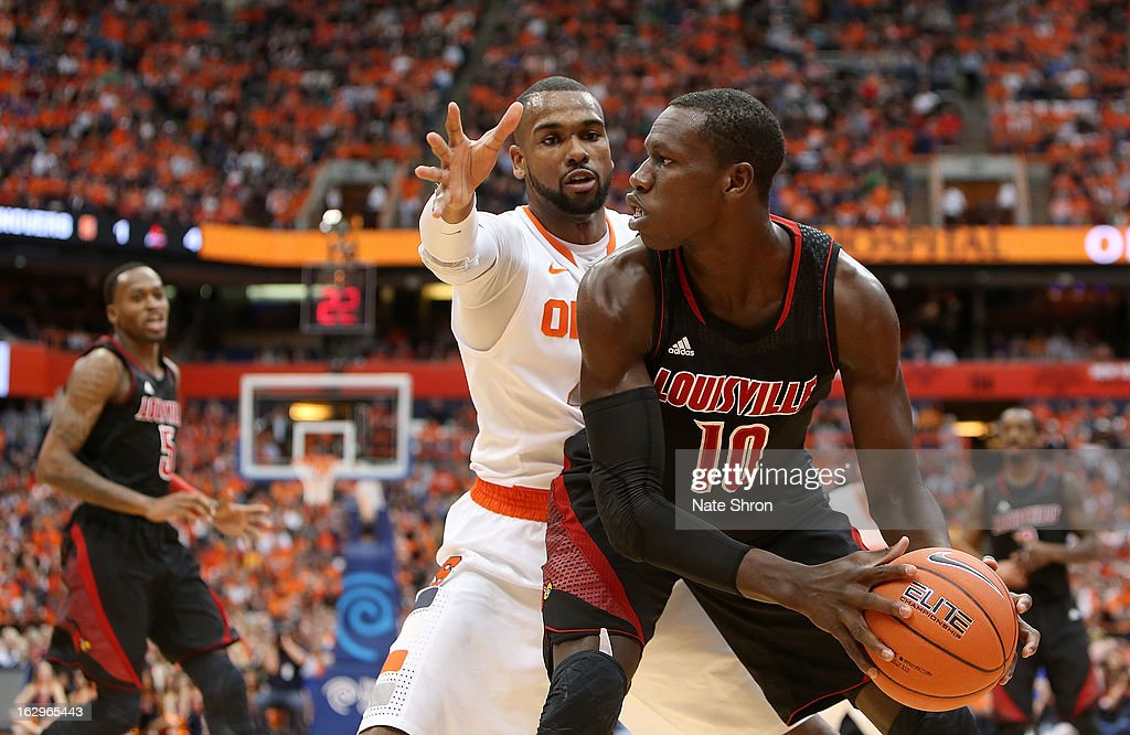 Gorgui Dieng #10 of the Louisville Cardinals holds the ball against James Southerland #43 of the Syracuse Orange during the game at the Carrier Dome on March 2, 2013 in Syracuse, New York.