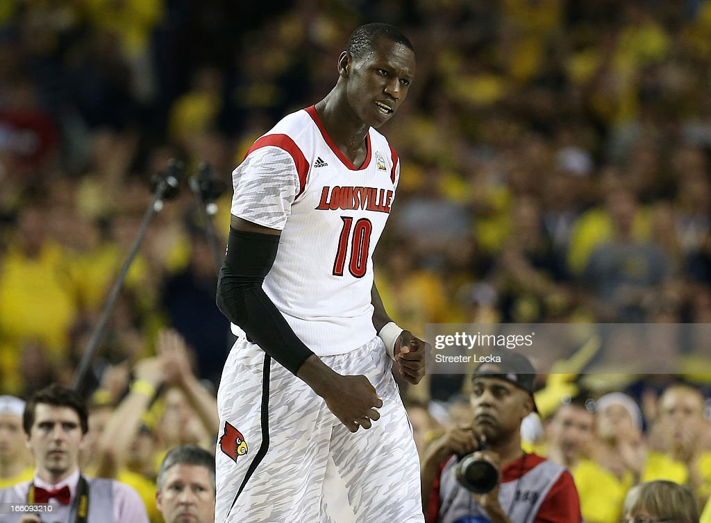 <a gi-track='captionPersonalityLinkClicked' href=/galleries/search?phrase=Gorgui+Dieng&family=editorial&specificpeople=7363274 ng-click='$event.stopPropagation()'>Gorgui Dieng</a> #10 of the Louisville Cardinals reacts in the first half against the Michigan Wolverines during the 2013 NCAA Men's Final Four Championship at the Georgia Dome on April 8, 2013 in Atlanta, Georgia.