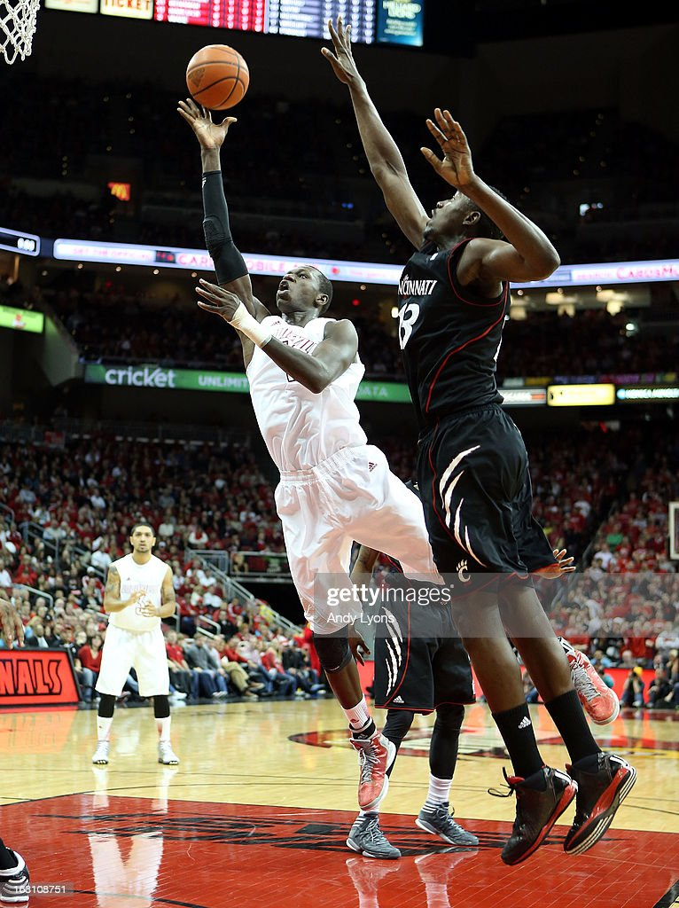 Gorgui Dieng #10 of the Louisville Cardinals shoots the ball during the game against the Cincinnati Bearcats at KFC YUM! Center on March 4, 2013 in Louisville, Kentucky.
