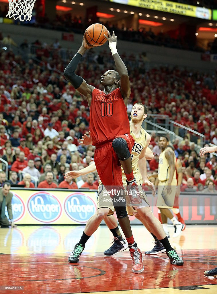 Gorgui Dieng #11 of the Louisville Cardinals shoots the ball during the game against the Notre Dame Fighting Irish at KFC YUM! Center on March 9, 2013 in Louisville, Kentucky.